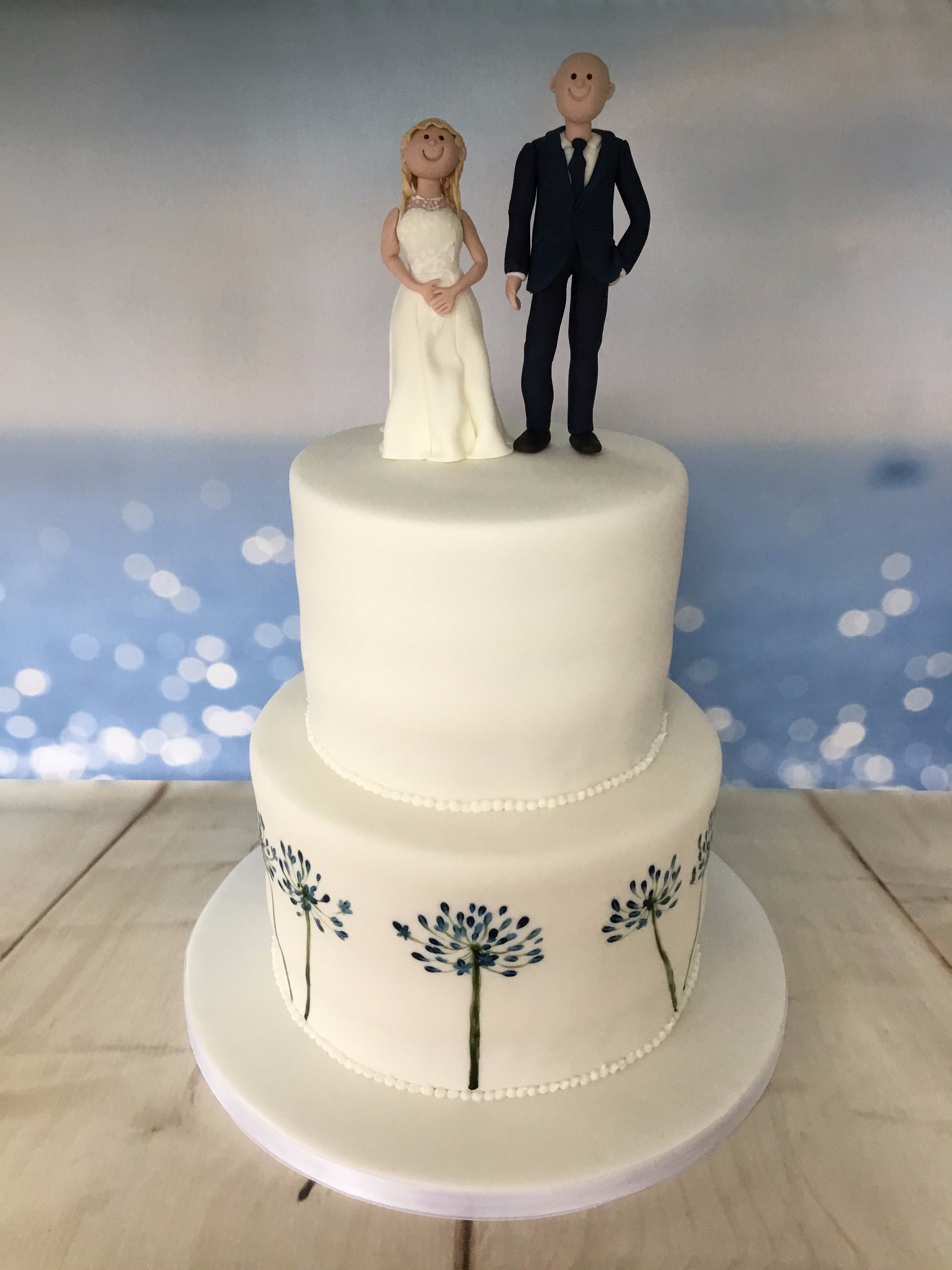 Bride and groom with painted agapanthus